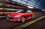 Red Tesla Model S luxury electric car speeding along a metal industrial tunnel