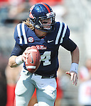 Mississippi quarterback Bo Wallace (14) rolls out vs. Auburn at Vaught-Hemingway Stadium in Oxford, Miss. on Saturday, October 13, 2012. (AP Photo/Oxford Eagle, Bruce Newman)..