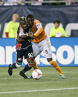 New England Revolution forward Dimitry Imbongo Boele (92) and Houston Dynamo defender Kofi Sarkodie (8) compete for the ball.  The New England Revolution played to a 1-1 draw against the Houston Dynamo during a Major League Soccer (MLS) match at Gillette Stadium in Foxborough, MA on September 28, 2013.