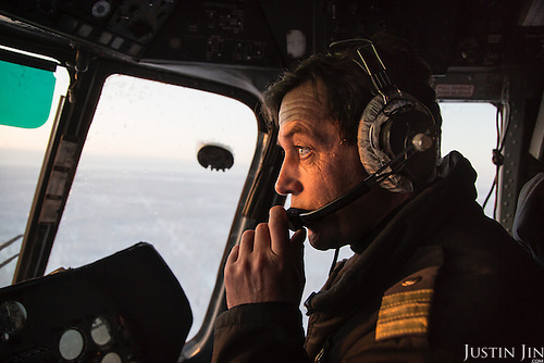 A helicopter pilot flies over gas fields across the Russian permafrost in Russia's Yamal region.