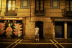 A man sleeps standing in the street of Estafeta before the fourth run of the bulls of the San Fermin festival, on July 10, 2012, in the Northern Spanish city of Pamplona. The festival is a symbol of Spanish culture that attracts thousands of tourists to watch the bull runs despite heavy condemnation from animal rights groups. (c) Pedro ARMESTRE