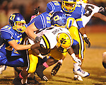 Oxford High's Joel Forrester (61), Oxford High's J.P. Bruscato (21), and Oxford High's Juan Edwards (20) make a tackle vs. Hernando in Oxford, Miss. on Friday, October 14, 2011. Hernando won 31-30 in overtime.