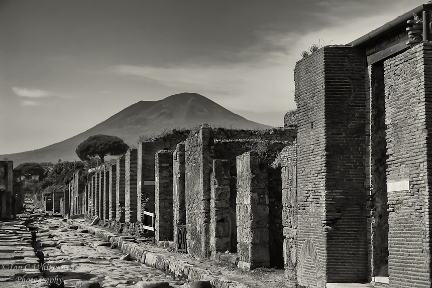 Pompeii ruins street view with Mount Vesuvius in the background.