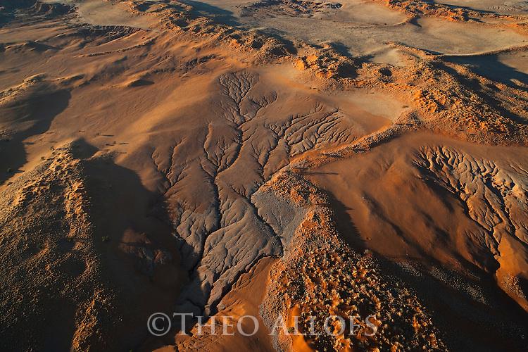 Namibia, Namib Desert, aerial of eastern edge of Namib Desert, sand dunes covered with vegetation