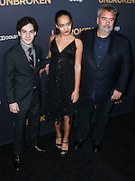 HOLLYWOOD, LOS ANGELES, CA, USA - DECEMBER 15: John D'Leo, Talia Besson, Luc Besson arrive at the Los Angeles Premiere Of Universal Pictures' 'Unbroken' held at the Dolby Theatre on December 15, 2014 in Hollywood, Los Angeles, California, United States. (Photo by Xavier Collin/Celebrity Monitor)