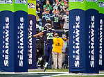 Seattle Seahawks cornerback Richard Sherman (25) is introduced before opening kickoff against the St. Louis Rams at CenturyLink Field in Seattle, Washington on December 28, 2014.  The Seahawks  wrapped up the No. 1 seed in the NFC playoffs after beating the Rams, 20-6. Despite the Cowboys and Packers also winning to finish 12-4, the Seahawks (12-4) won the multi-team tiebreaker and earned home-field advantage throughout the playoffs for the second consecutive season.  ©2014. Jim Bryant Photo. All Rights Reserved.