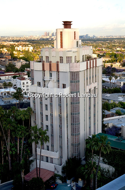 the Art Deco Sunset Tower Hotel on the Sunset Stri with Downtown Los Angeles in the background