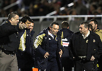 Peter Nowak coach of the Philadelphia Union is escorted from the field by the police after receiving a red card during a play-in game for the US Open Cup tournament against D.C. United at Maryland Sportsplex, in Boyds, Maryland on April 6 2011. D.C. United won 3-2 after overtime penalty kicks.