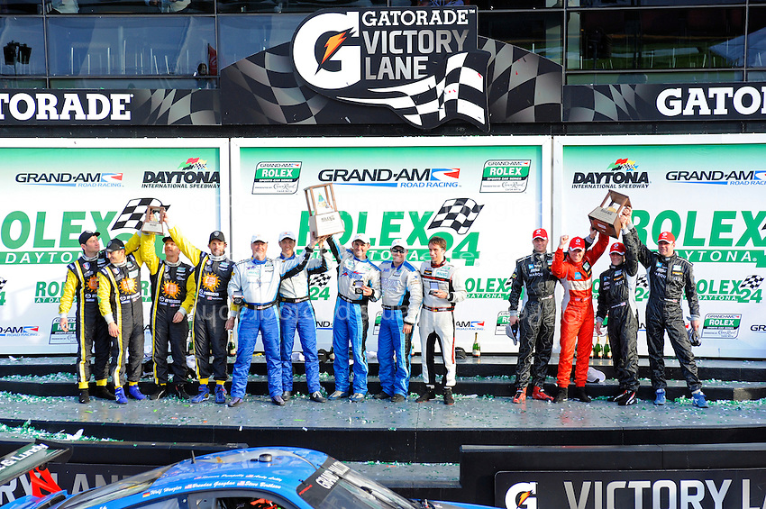 GT winners: (L to R): #40 Dempsey Racing RX-8 of Patrick Dempsey, Joe Foster, Charles Espenlaub & Tom Long, 3rd., #67 TRG Porsche GT3 Cup of Steven Bertheau, Brenden Gaughan, Wolf Henzler, Andy Lally & Spencer Pumpelly, 1st and #48 Paul Miller Racing Porsche GT3 Cup of Bryce Miller, Tim Sugden, Brian Sellers & Rob Bell, 2nd.