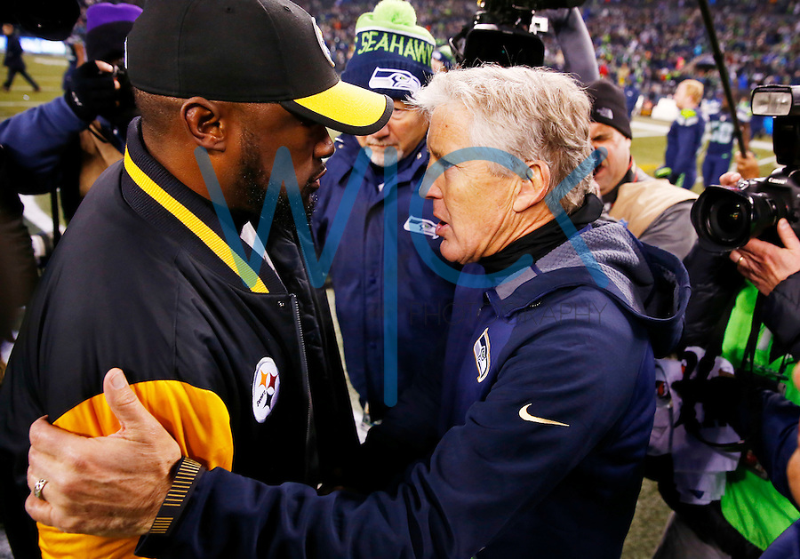 Head coaches Mike Tomlin of the Pittsburgh Steelers and Pete Carrol of the Seattle Seahawks shake hands following the game at CenturyLink Field on November 29, 2015 in Seattle, Washington. (Photo by Jared Wickerham/DKPittsburghSports)