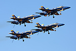Four Blue Angels aircraft perform the Dirty Formation Pass as part of the Blue Angels flight demonstration over San Francisco Bay. The Blue Angels were the featured aerial performers of the 2008 San Francisco Fleet Week event. The Blue Angels fly the Boeing built F/A-18 Hornet.