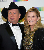 Garth Brooks and Tricia Yearwood arrive for the formal Artist's Dinner honoring the recipients of the 39th Annual Kennedy Center Honors hosted by United States Secretary of State John F. Kerry at the U.S. Department of State in Washington, D.C. on Saturday, December 3, 2016. The 2016 honorees are: Argentine pianist Martha Argerich; rock band the Eagles; screen and stage actor Al Pacino; gospel and blues singer Mavis Staples; and musician James Taylor.<br /> Credit: Ron Sachs / Pool via CNP