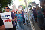 Supporters of gay rights march through downtown Mountain View June 27 in celebration of the Supreme Court's overturn of Proposition 8.