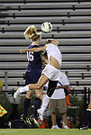 29 September 2011: Virginia's Maggie Kistner (16) heads the ball over Duke's Kaitlyn Kerr (right). The Duke University Blue Devils and the University of Virginia Cavaliers played to a 0-0 tie after overtime at Koskinen Stadium in Durham, North Carolina in an NCAA Division I Women's Soccer game.