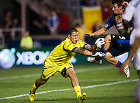 Real Salt Lake goalkeeper Nick Rimando (18) denies Jack McInerney (9) of the Philadelphia Union late in the game. The Philadelphia Union and Real Salt Lake played to a 0-0 tie during a Major League Soccer (MLS) match at PPL Park in Chester, PA, on August 24, 2012.