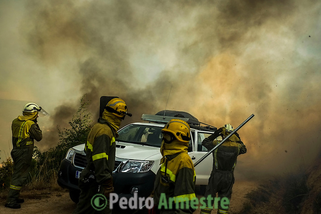 Firefighters work at the site of a wildfire in monterrei in verín