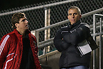 13 November 2009: New York Red Bulls interim head coach Richie Williams (right) and Chivas USA Vice President of Soccer Operations Stephen Hamilton talk while watching the game. The University of Virginia Cavaliers defeated the Wake Forest University Demon Deacons 4-3 on penalty kicks after the game ended in a 0-0 tie after overtime at WakeMed Stadium in Cary, North Carolina in an Atlantic Coast Conference Men's Soccer Tournament Semifinal game.