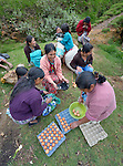 Participants divide up the eggs produced in a women's cooperative poultry raising project in Buena Vista Bacchuc, a small Mam-speaking Maya village in Comitancillo, Guatemala. The project is assisted by the Maya Mam Association for Investigation and Development (AMMID).