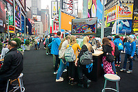 Shoppers browse the new Windows 8 operating system software at a promotional event using hardware from various manufacturers in Times Square in New York on its launch date, Friday, October 26, 2012. Microsoft is billing Windows 8 as the greatest overhaul of its predominant operating system in 20 years. (© Richard B. Levine)