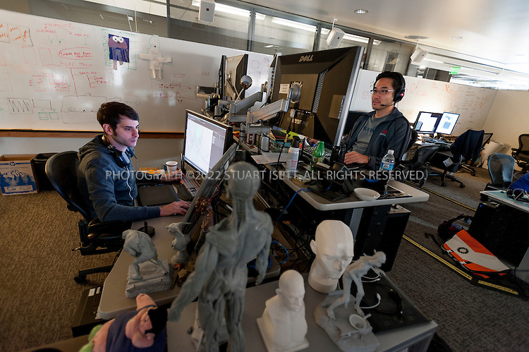 8/2/2012--Bellevue, WA, USA..Animators and artists working on 'Dota 2' at Valve Software's offices in Bellevue, WASH., just east of Seattle. The office is set up as a 'boss less' office that is fluid and non-hierarchical. Desks come with wheels so that they can be easily moved and reconfigured to create new work spaces for new projects. The desks can also be raised or lowered for comfort or to create a standing work space...©2012 Stuart Isett. All rights reserved.