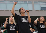 Jamie Kosiorek, an outside hitter for the volleyball team, teaches first-year students the Ohio University fight song in Peden Stadium on Saturday, August 20, 2016. © Ohio University / Photo by Kaitlin Owens