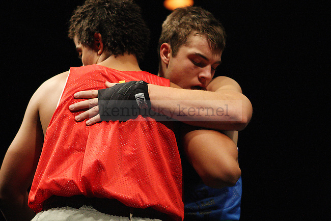 Evan Fisher of Phi Kappa Psi and Fredrick Williams of Alpha Tau Omega hug it out after their bout during The Main Event hosted by Alpha Delta Pi and Sigma Chi  at the Lexington Convention Center in Lexington, Ky., on Thursday, November 7, 2013. Photo by Michael Reaves | Staff