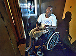 Blessing Manditsera lives in a condemned apartment building not far from his stand in the Mbare Market in Harare, Zimbabwe. Manditsera's legs were paralyzed when he suffered from tuberculosis, and he today uses a wheelchair provided by the Jairos Jiri Association with support from CBM-US.