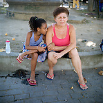 Residents of Largo do Tanque watch the demolition of homes in Rio de Janeiro's West Zone, to make room for the Transcarioca Highway, that will eventually be built to accommodate the Olympics, in Rio de Janeiro, Brazil, on Monday, Feb. 25, 2013. <br /> <br /> In less than 2 weeks, 54 houses were demolished with sledgehammers and bulldozers. In under 2 weeks, 54 houses were demolished and hundreds of residents left to fend for themselves. The City assessor sent to handle negotiations told residents not to speak with one another or seek legal advice otherwise he would reduce settlement offers. Many residents agreed to compensations, around R$7000 (US$3500). Most residents cannot afford to buy a plot of land with that compensation and will be forced to rent kitchenettes, at less than 20m2. As established in the Brazilian Constitution, and in accordance with local legislation (the Organic Municipal Law), the duration of residents' life in the area gave them legal rights to the homes, while compensation should allow them to attain an equal situation elsewhere. <br /> <br /> The west zone, located west of downtown and beach neighborhoods is often overlooked and is widely known to be run by militia groups, who are former and current police and firefighter personnel that run extortion rings to monopolies.