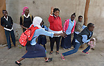 Young refugees play between classes in a school operated by St. Andrew's Refugee Services in Cairo, Egypt. The program is supported by Church World Service.