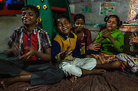 Boatmen's children clap during a meditation class in the Boat School Guria runs on the holy Ganges River, in Varanasi, Uttar Pradesh, India on 11 November 2013. The school aims to take the boatmen's children away from working in the tourist areas where they are exposed to trafficking and sexual abuse.