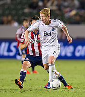 CARSON, CA - July 7, 2012: Vancouver Whitecaps midfielder Barry Robson (14) during the Chivas USA vs Vancouver Whitecaps FC match at the Home Depot Center in Carson, California. Final score Vancouver Whitecaps FC 0, Chivas USA 0.
