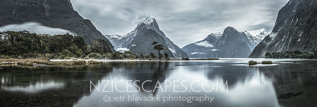 Pre-dawn Milford Sound in winter with morning reflections of Mitre Peak 1692m, Fiordland National Park, Southland, World Heritage Area, New Zealand
