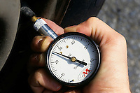 TIRE PRESSURE GAUGE<br /> (Variations Available)<br /> The compression of the spring is proportional to the force on it, which is in turn proportional to the air pressure in the tire.
