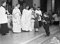 Episcopal Ordination Of Desmond Connell. (R74).1988..06.03.1988..03.06.1988..6th March 1988..Following the death of Archbishop Kevin McNamara in April '87, Pope John Paul II surprisingly nominated Desmond Connell for the position of Archbishop of Dublin. The ordination of Dr Connell took place at the Pro-Cathedral in Dublin...Archbishop Desmond Connell is pictured greeting young children as the carry the gifts to the altar for mass.