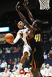 "Mississippi's Dundrecous Nelson (5) is fouled by Grambling State's Peter Roberson (40) during the first half at the C.M. ""Tad"" Smith Coliseum in Oxford, Miss. on Monday, November 14, 2011. (AP Photo/Oxford Eagle, Bruce Newman).."