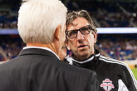 Toronto FC head coach Paul Mariner talks with New York Red Bulls head coach Hans Backe. The New York Red Bulls defeated Toronto FC 4-1 during a Major League Soccer (MLS) match at Red Bull Arena in Harrison, NJ, on September 29, 2012.