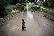 A young boy is seen in a canal in Rae Bareli, Uttar Pradesh, India. Canal are the main source of irrigation water for the whole region. The 4 month annual rainfall is crucial to summer sown crops as 60% of the farmlands are rainfed. North India experienced scanty rainfall in late june to july. Till August, rain in India has been 26% below 5 year average. Late rains moist the fields but it is not enough for rice, sugarcane, oilseeds and pulses. Late rains also damage the alternate crops that need less water.