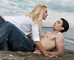 Young man and a woman on the beach