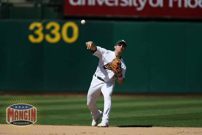 OAKLAND, CA - SEPTEMBER 15:  Marco Scutaro of the Oakland Athletics plays defense at shortstop during the game against the Texas Rangers at the McAfee Coliseum in Oakland, California on September 15, 2007.  The Athletics defeated the Rangers 7-3.  Photo by Brad Mangin