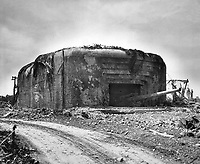 Monster Nazi gun battery silenced in France.  This German gun emplacement has walls of concrete 13 feet thick and four guns each with a 10 1/4&quot; bore.  This particular position was bombed out of action by Allied flyers. Ca. 1944. Albert Thompson.  (Coast Guard)<br /> Exact Date Shot Unknown<br /> NARA FILE #:  026-G-2513<br /> WAR &amp; CONFLICT BOOK #:  1046