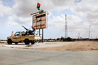 A rebel checkpoint at the edge of Tobruk, guarding the desert road from Agdabia. On 17 February 2011 Libya saw the beginnings of a revolution against the 41 year regime of Col Muammar Gaddafi. .