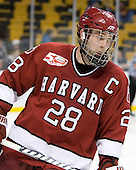 Chris Huxley (Harvard - 28) - The Harvard University Crimson defeated the Boston University Terriers 5-4 in the 2011 Beanpot consolation game on Monday, February 14, 2011, at TD Garden in Boston, Massachusetts.