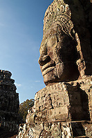 Over 200 enigmatic half smiling faces are carved into the structure at the Bayon, one of the ancient temples at Angkor, Cambodia