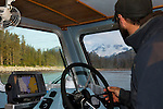 A boat arrives at Shelter Creek along Cook Inlet in Lake Clark National Park, Alaska.  Mt Iliamna, an active volcano, can be seen through the window of the vessel.  Photo by Gus Curtis.