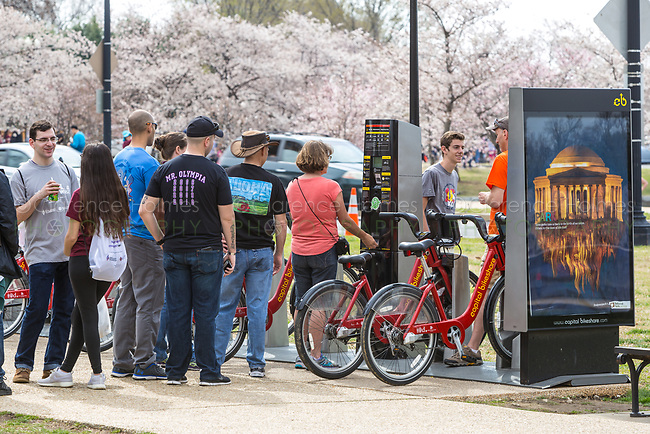 People rent bikes at a Capitol Bikeshare station at 17th St & Independence Ave SW in Washington, DC.