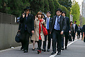 Japanese artist Megumi Igarashi (C) holds her fiance's hand Mike Scott of The Waterboys (L) upon her arrival at the Tokyo District Court on April 13, 2017, Tokyo, Japan. Igarashi also known as Rokudenashiko was declared partly innocent by the Tokyo District Court, today April 13, after first being arrested in 2014 for distributing 3D data of her genitals as part of a crowd funding project to make a kayak based on her vulva. She had been found guilty in 2016 of breaking obscenity laws and fined JPY 400,000 but appealed that ruling. She was found guilty of distributing obscene data via the internet but innocent for displaying her art. (Photo by Rodrigo Reyes Marin/AFLO)