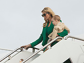 Ivanka Trump carries her child she departs the aircraft carrying President-elect of The United States Donald Trump arrives Joint Base Andrews in Maryland January 19, 2017the day before his swearing in as 45th President of The United States. <br /> Credit: Chris Kleponis / Pool via CNP