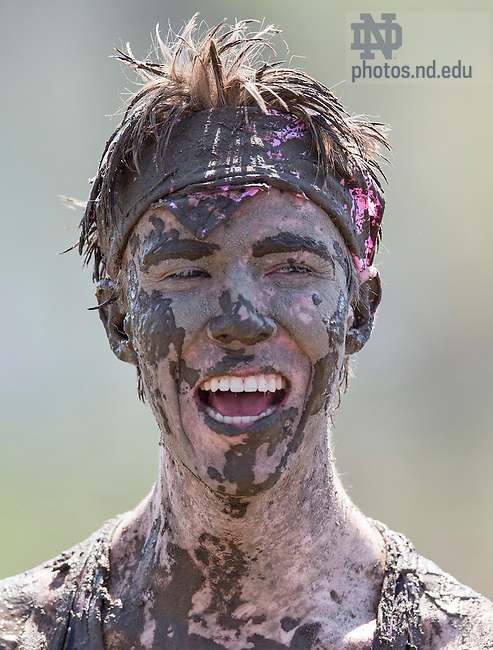 April 26, 2015; Freshman Daniel Riley enjoys Muddy Sunday, a volleyball tournament played at White Field to support Habitat for Humanity. Photo by Barbara Johnston/University of Notre Dame
