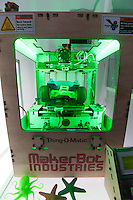 "A MakerBot Industries ""Thing-O-Matic"" 3d printer is seen in the Wired pop-up store in Times Square in New York on Wednesday, November 23, 2011. The device, which may revolutionize small industry, enables the user to produce small plastic objects manufactured via extrusion on their desktop via this automated machine. (© Richard B. Levine)"