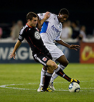 Khari Stephenson (7) of San Jose fights for the ball with Stephen King (20) of D.C. United during a game at RFK Stadium in Washington, DC.  San Jose defeated D.C. United, 2-0.